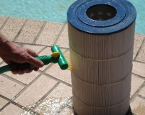 Aqua Comb pool and spa filter cleaning device.