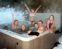 Winter fun in the holiday hot tub for the whole family.